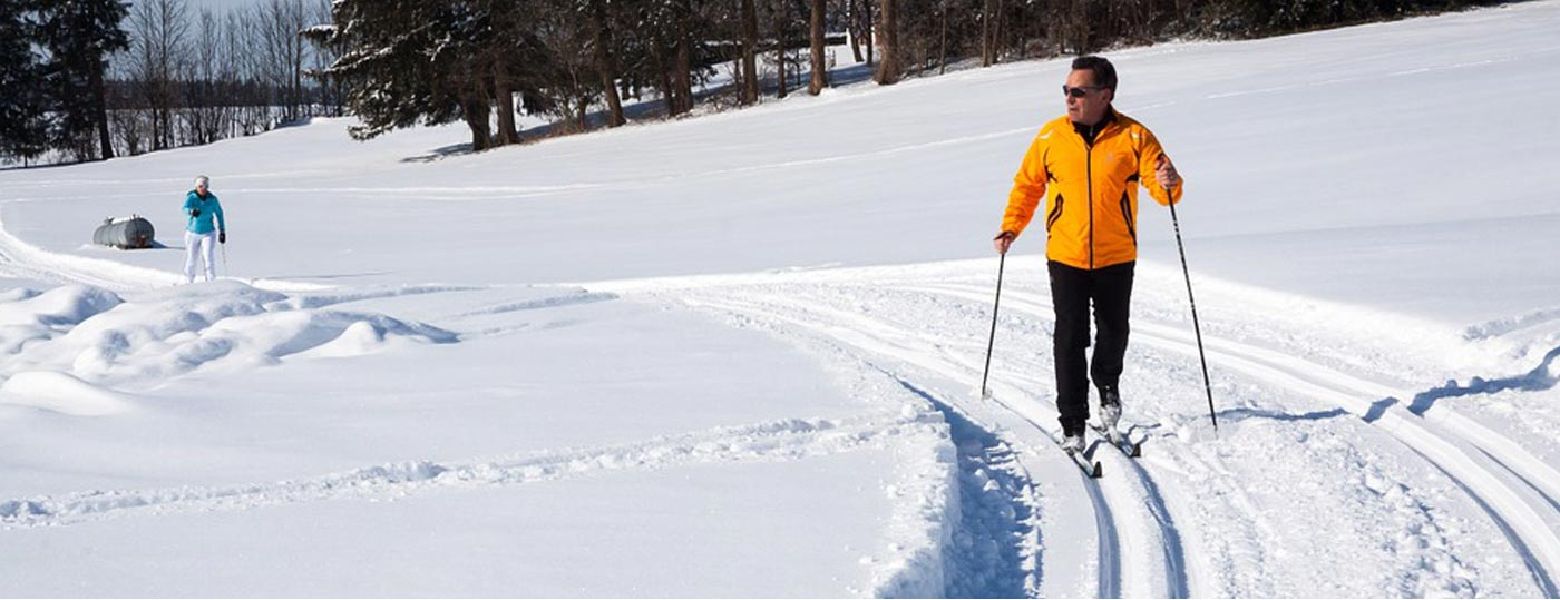 Guests enjoy nordic ski trails at Garnet Hill Lodge & Ski Resort in the Adirondacks