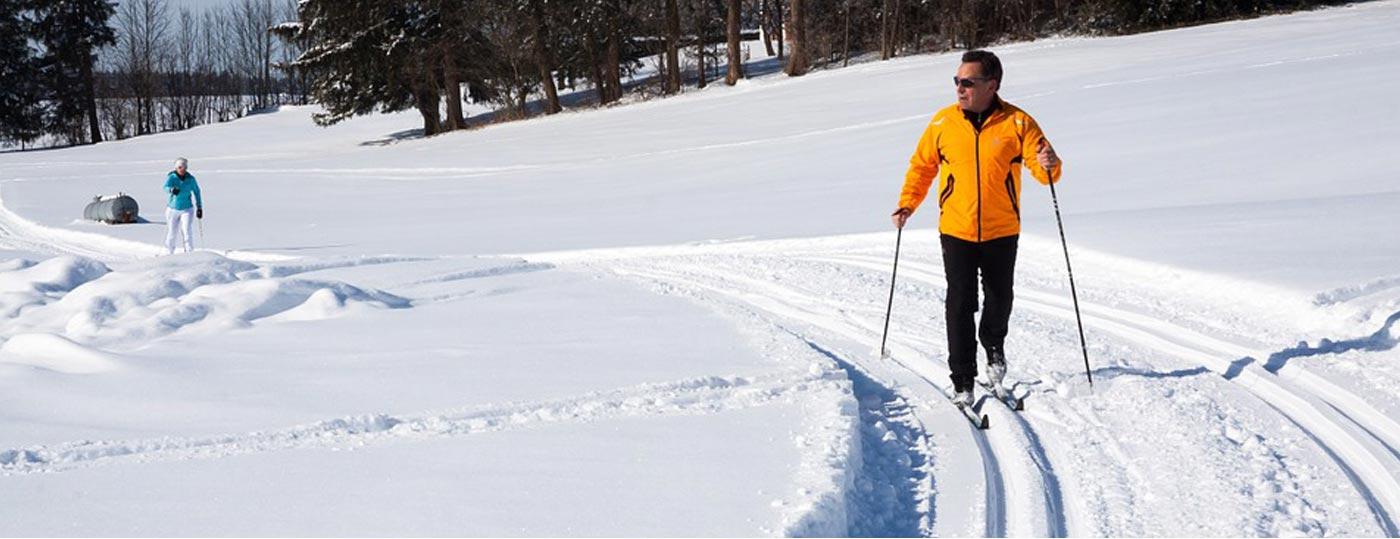 Guests enjoy nordic ski trails at Garnet Hill Lodge & Ski Resort in the Adirondacks