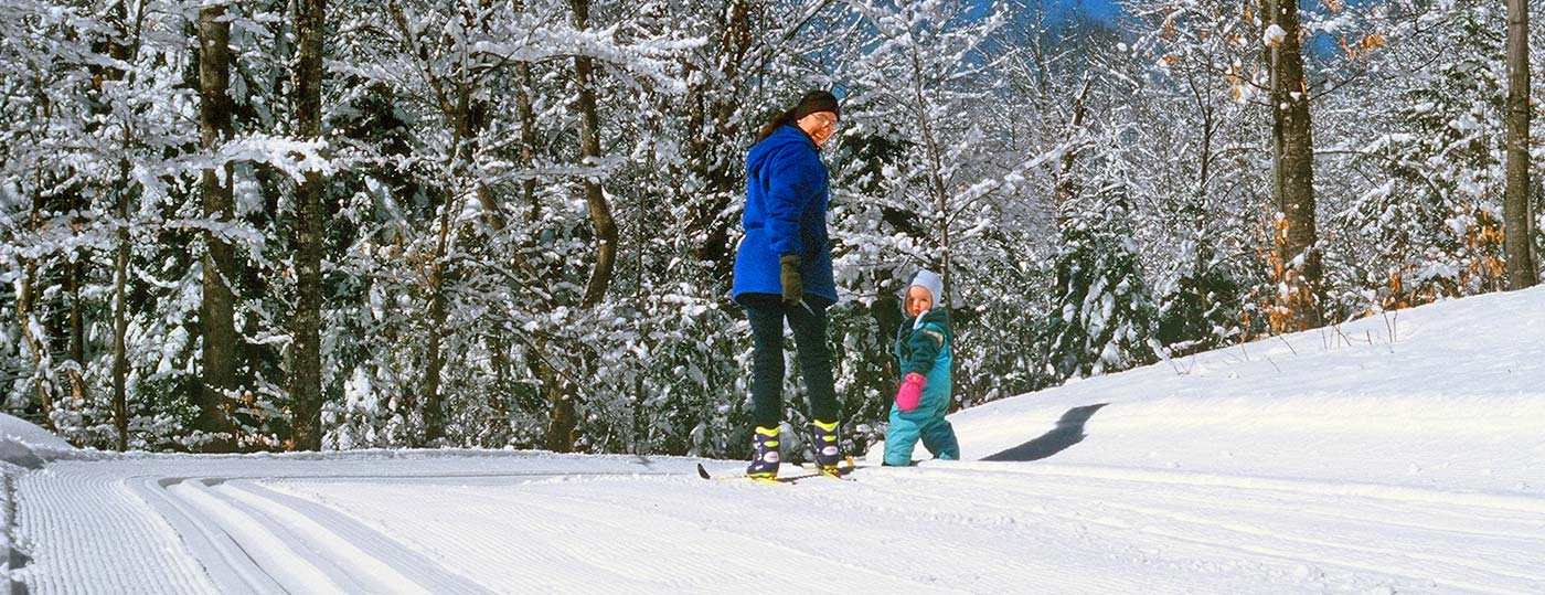 Mother and child enjoying Garnet Hill's 55 miles of cross country skiing trails