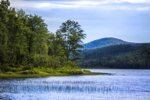 A pristine Adirondack Lake surrounded by mountains