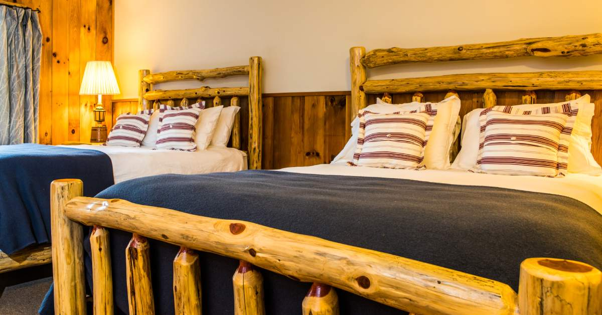 two beds with rustic bed frames