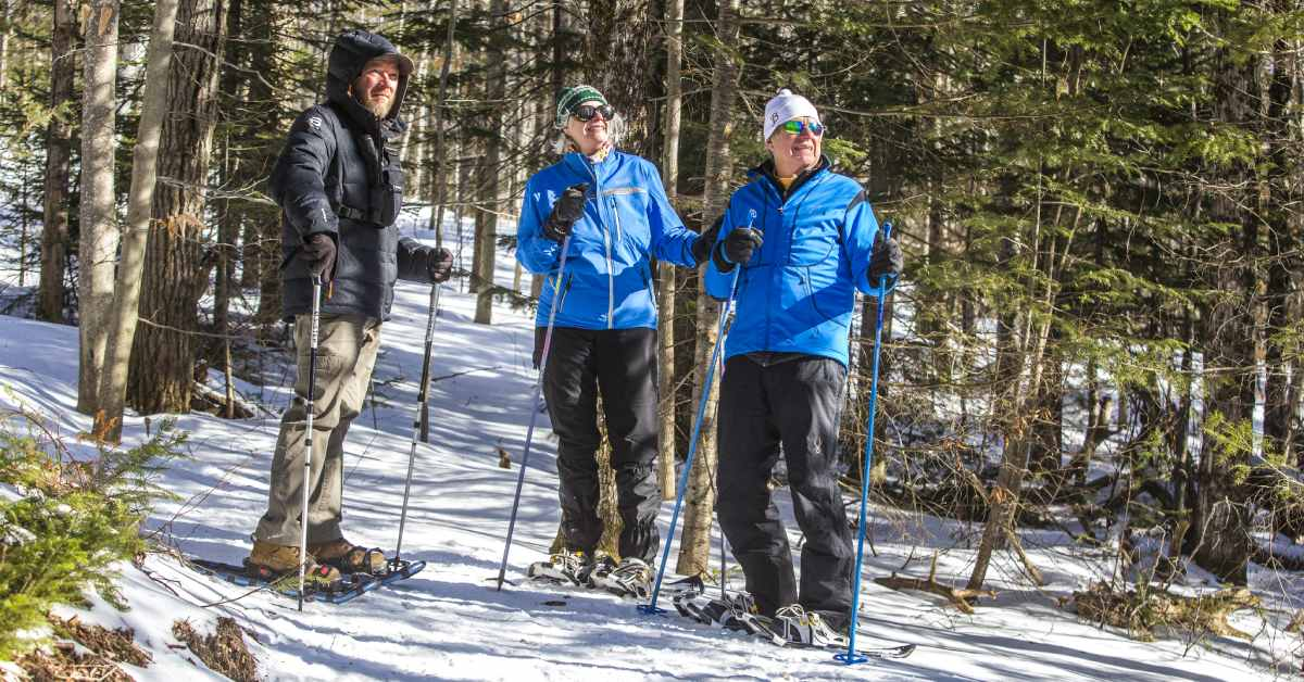 three people on snowshoes