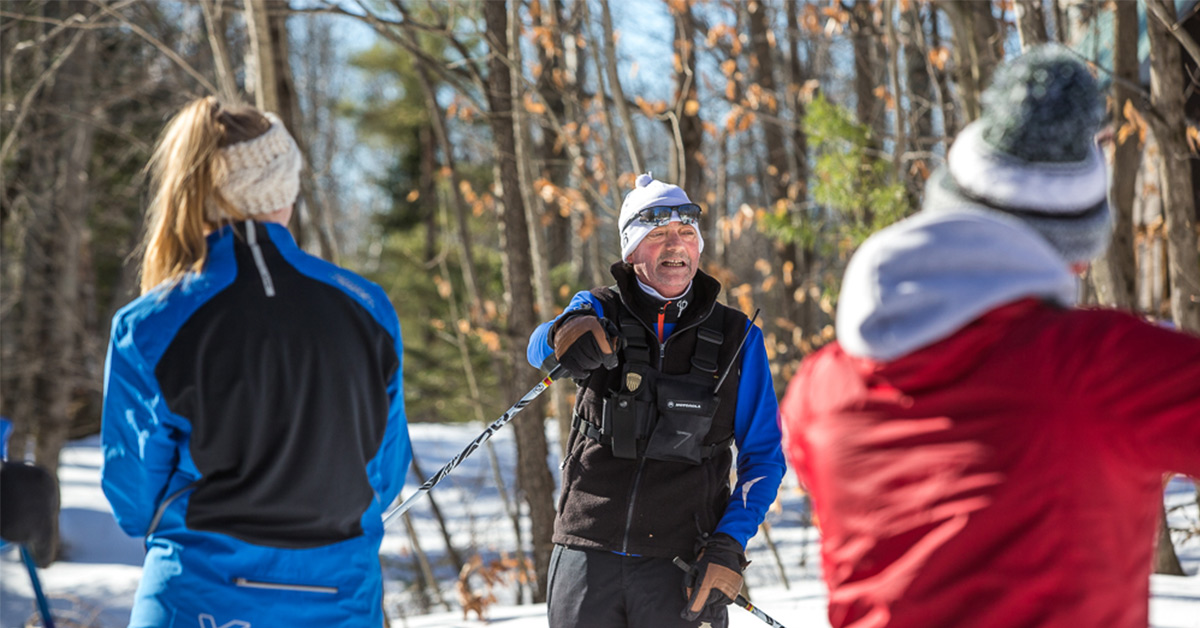 person giving cross-country skiing instructions