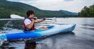 man kayaks