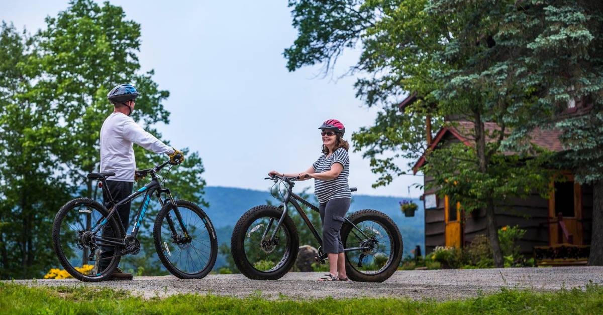two adults on mountain bikes