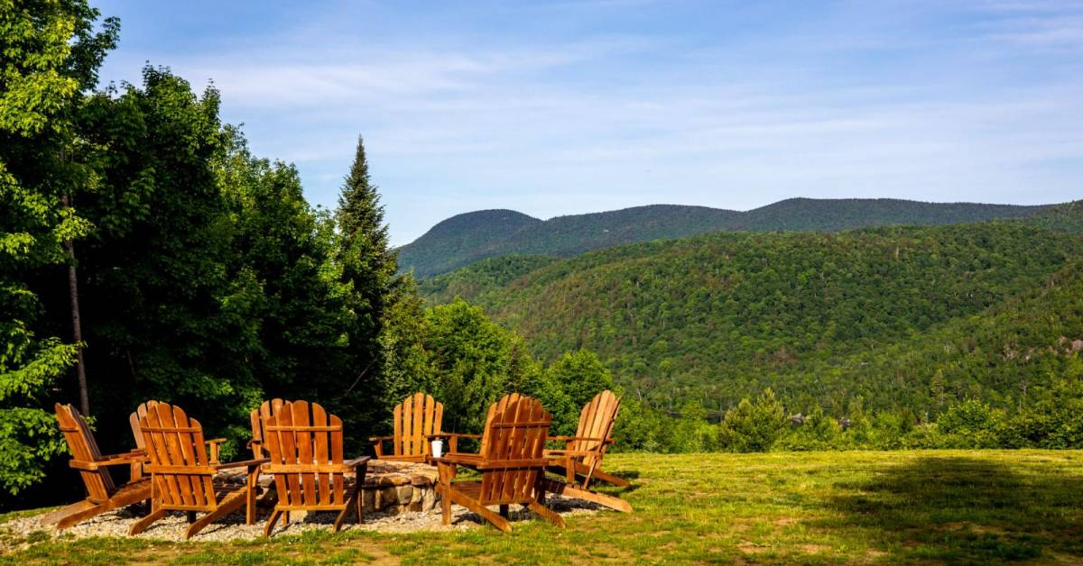 view of mountains and adirondack chairs