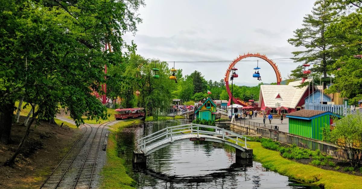 train tracks, water, amusement park rides